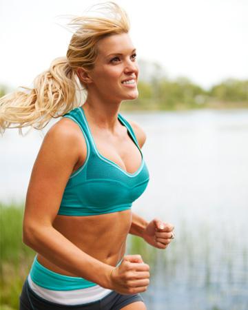 Woman running wearing sports bra