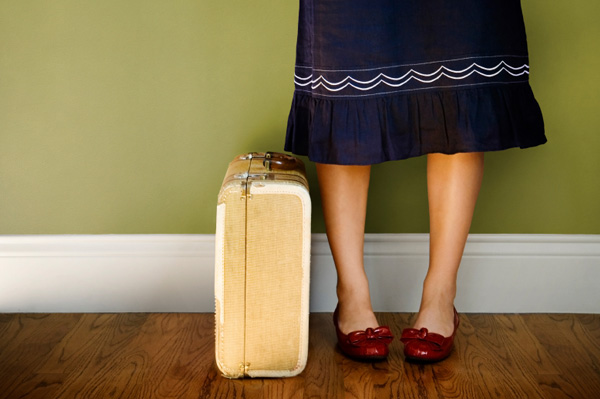 Suitcase by a woman's legs