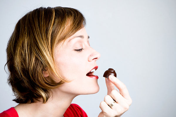 Woman eating candy | Sheknows.com