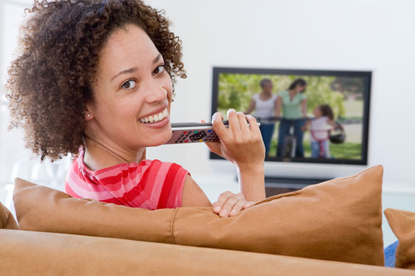Woman watching television | Sheknows.com