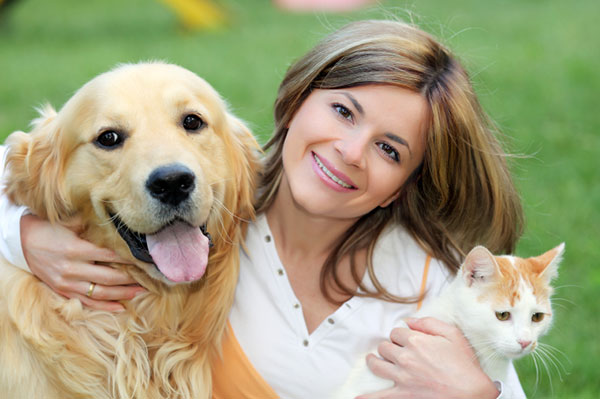 Woman with dog and cat | Sheknows.com