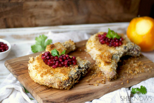 Orange crusted crispy pork chops with bourbon soaked pomegranate seeds