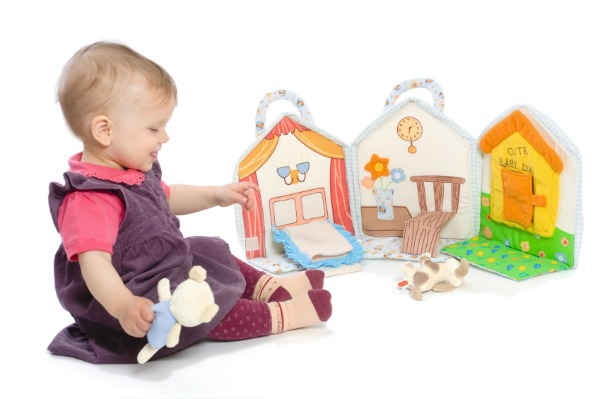 Toddler engages in imaginative play