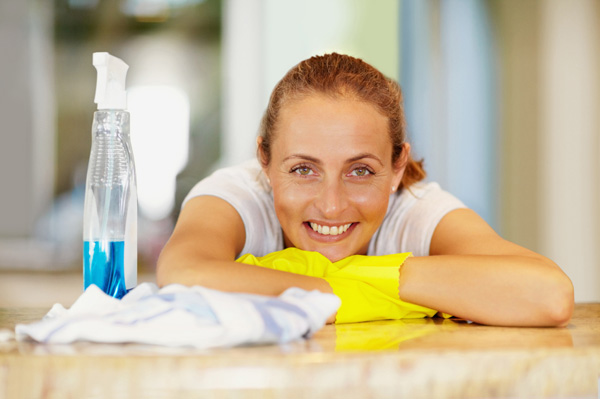 Smiling woman cleaning
