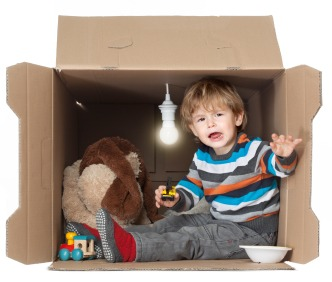 toddler-boy-in-box-fort