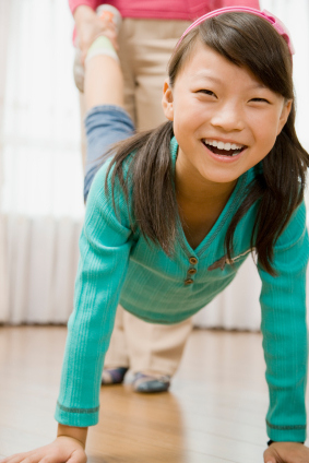 young tween girl exercising or playing