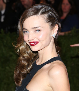 Miranda Kerr's perfect party hair makeup with a dark twist