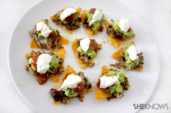individual-nachos-step-14-top-with-sour-cream.jpg