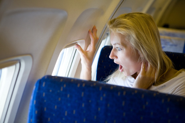 Fearful woman on plane