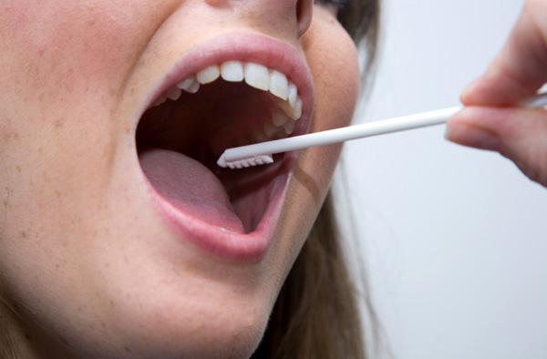 Woman getting mouth swabbed