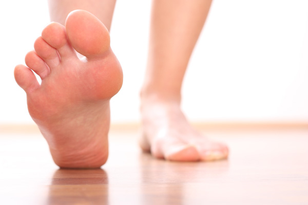 Woman with heel pain