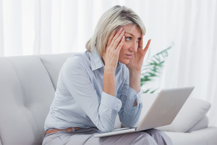 Worried woman on computer