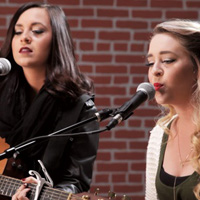 "Watch Megan & Liz perform ""All Alright."""