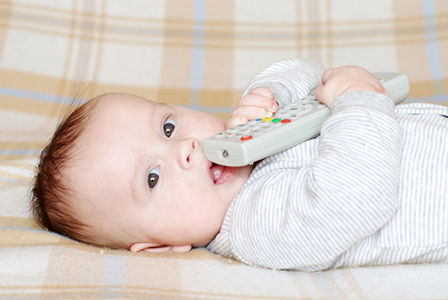 Adorable baby eating television remote | Sheknows.com