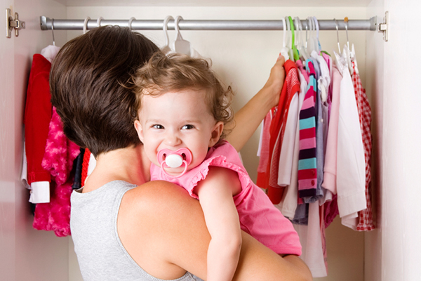 Mother picking out a baby outfit | PregnancyAndBaby.com
