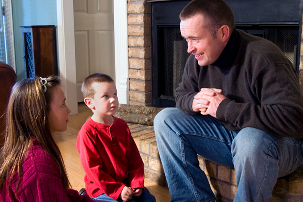 Father telling a story to his children | Sheknows.com