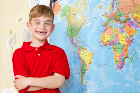 Happy school boy with map | Sheknows.com
