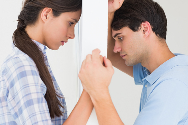 Man and woman holding hands and worried | PregnancyAndBaby.com