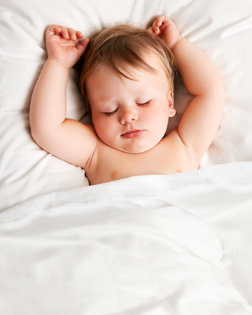 Relaxed sleeping baby | Sheknows.com