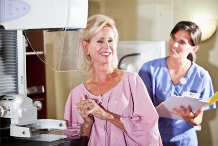 Nurse with patient getting mammogram