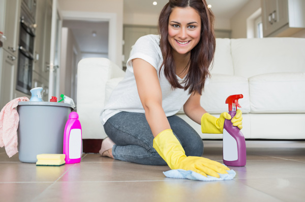 Woman cleaning apartment