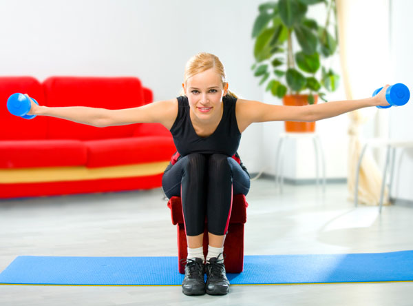 Young happy woman doing exercises