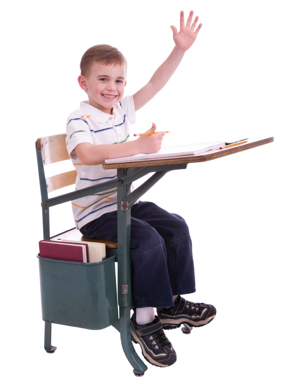 little boy sitting at school desk