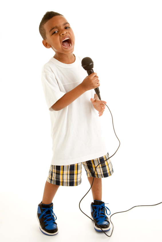 young boy singing into microphone