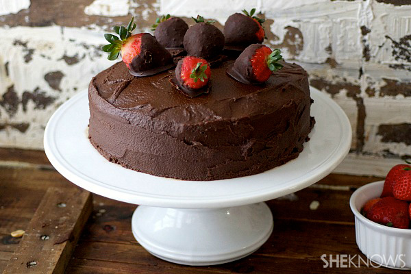 Strawberry cake with brownie frosting and chocolate covered strawberries