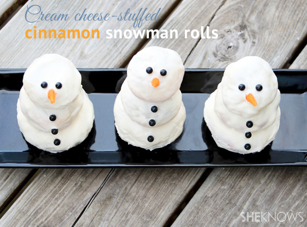 Cream cheese-stuffed cinnamon snowman rolls | SheKnows.com