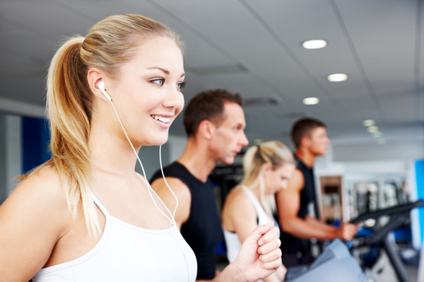 Woman wearing headphones at gym