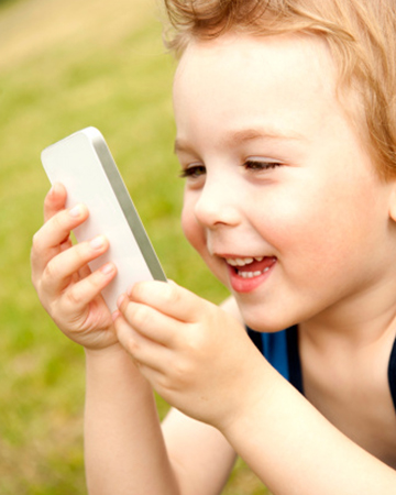 Boy using cellphone | Sheknows.com
