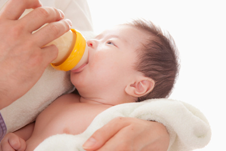 Baby drinking from bottle | Sheknows.com