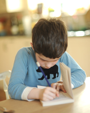 Boy writing | Sheknows.com
