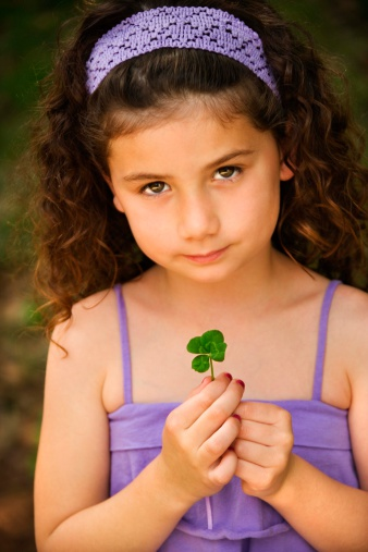 Grade school girl with clover | Sheknows.com