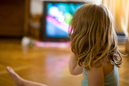Young girl watching television | Sheknows.com