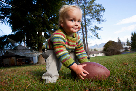 Toddler playing football | Sheknows.com