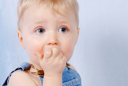 Toddler with fingers in mouth | Sheknows.com