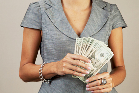 Woman with a handful of twenties   Sheknows.com