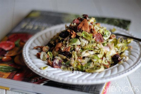 Shaved brussels sprouts with almonds, dried cherries and warm bacon dressing