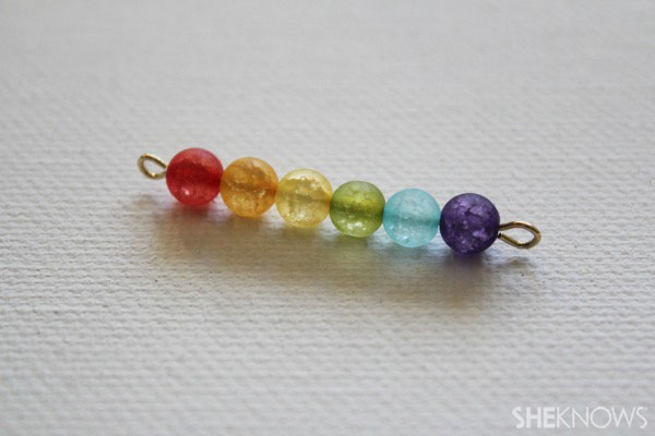 String your rainbow beads onto a second eyepin curl ends