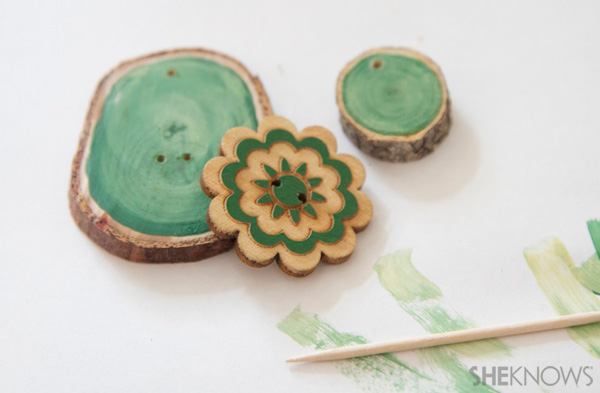 wood disk gift tags Step 2: Glue or Sew on button