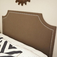 Upholstered headboard with nailhead trim