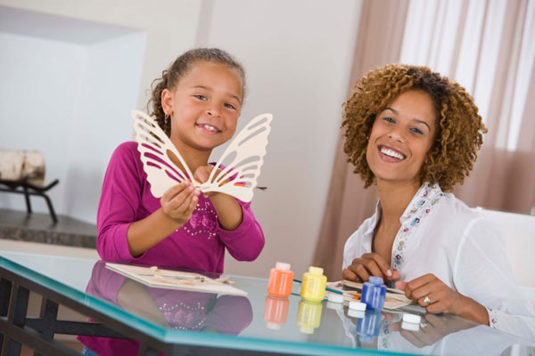 Mother and daughter doing arts and crafts