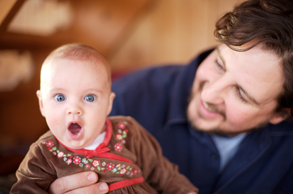Dad with shocked baby