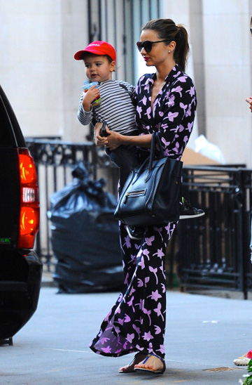 Miranda Kerr donned a spring-perfect maxi-esque version of the classic wrap dress out and about with her son in New York City last year.