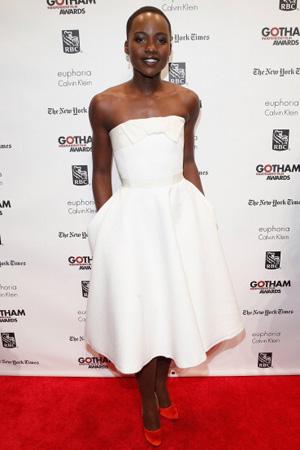 Lupita Nyong'o wearing dress with oversize bow and pockets