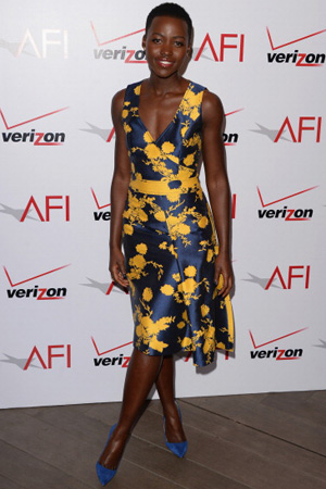 Lupita Nyong'o wearing a classic Carolina Herrera knee-length dress