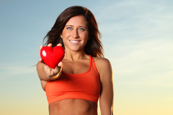 Fit woman holding heart