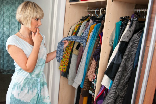 Woman looking at clothes in her closet